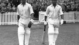 Sir Everton Weekes, right, strolls out to bat with Sir Frank Worrell.